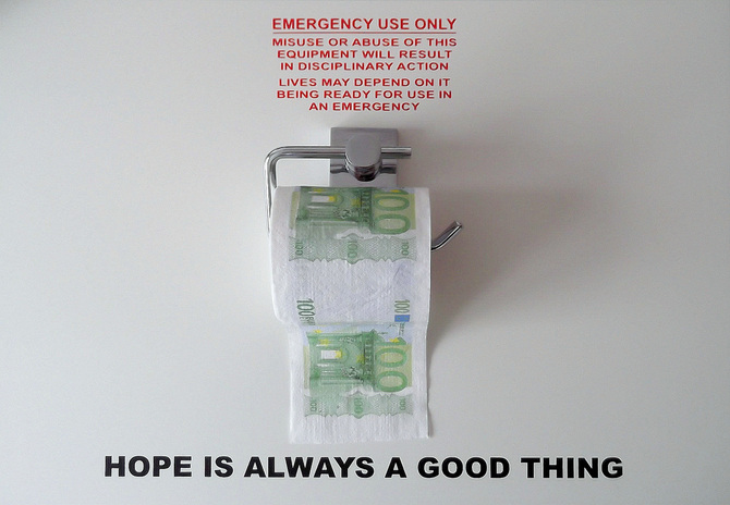 Naoki Fuku  Quantitative easing (2013) toilet holder, toilet Role, emergency sign on white wooden board 40 x 55 x 20cm