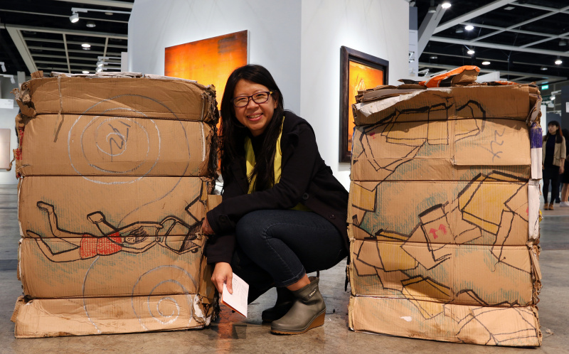 Tintin Wulia poses with Five Tonnes of Homes and Other Understories. Photo: Evangeline SM Lam ©Prestige