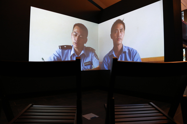 Zhang Peili. Q + A + Q, 2012. 2-channel video projection installation; 20:37; installation view, Q + A + Q, 2012. Courtesy of the Artist and Australian Centre on China in the World.